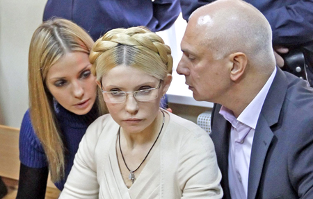 Yulia Tymoshenko (in the middle) with her husband and daughter. Photo: icanhascheezburger.com